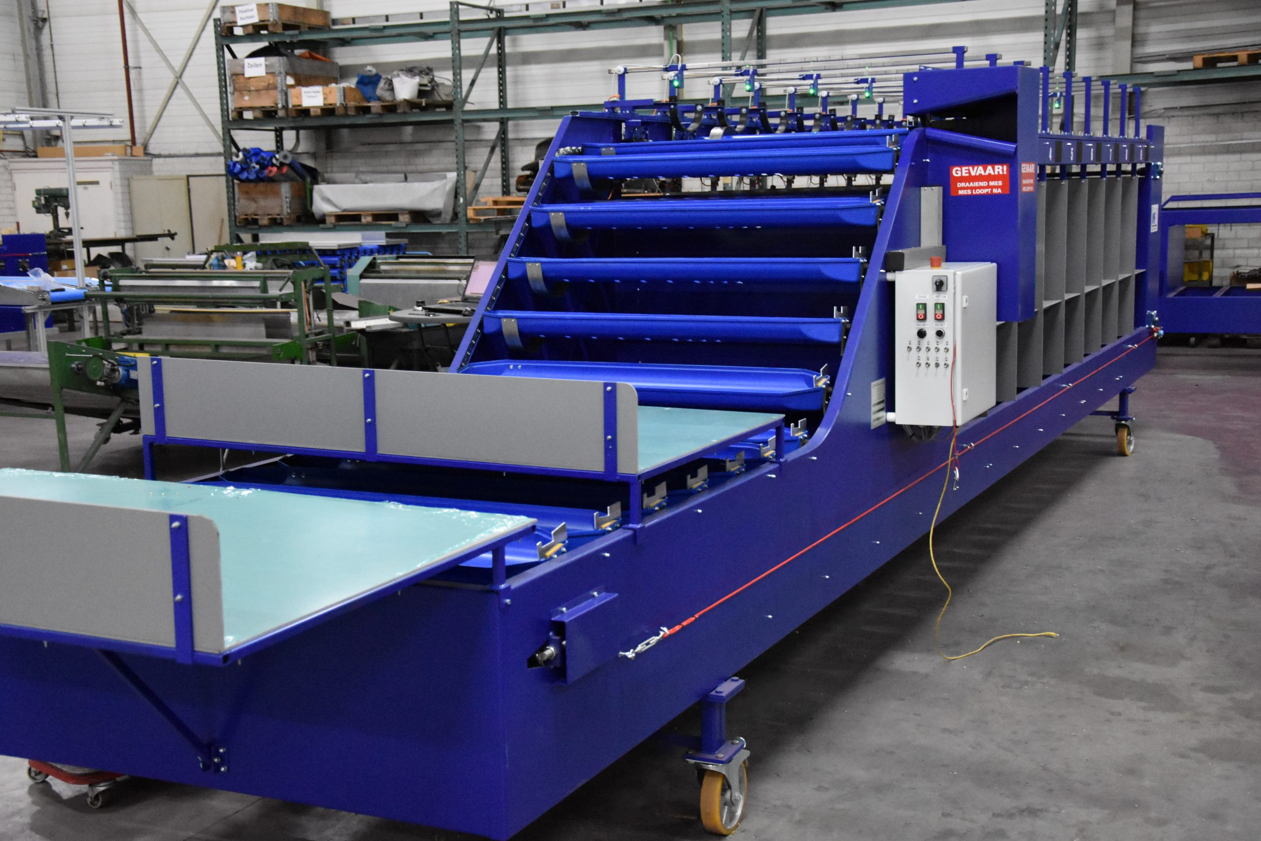 Length grading machine for volume products Image